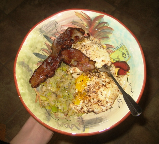 Eggs fried in bacon fat, leeks and of course, bacon, all locally grown ...