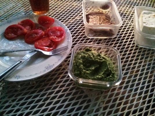 Sliced tomatoes, arugula pesto, feta cheese and flax bread for dinner!