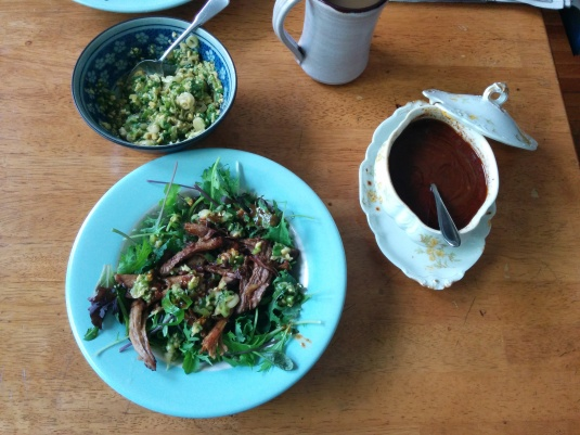 Left over Bo Ssam over salad greens with ginger scallion and ssam sauce.